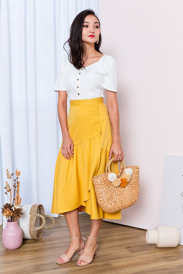 Ariel Asymmetrical Buttons Skirt in Mustard