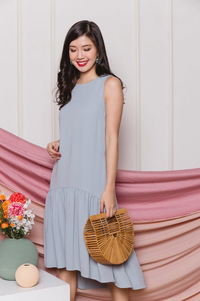 Della Drop Hem Dress in Dust Blue