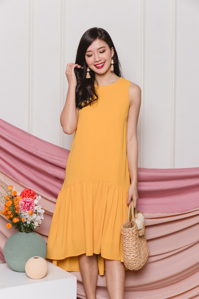 Della Drop Hem Dress in Sunshine